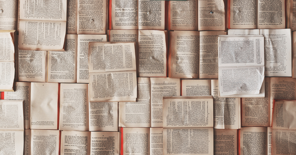 open books spread out all over the surface with no space to illustrate long form content
